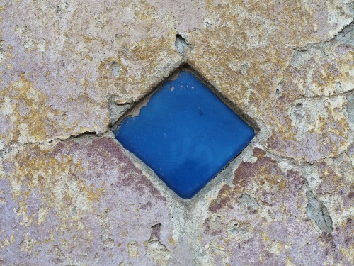 Rough Painted Wall with Blue Stone