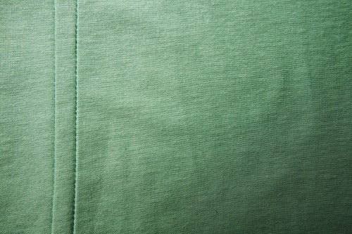 Green Fabric Texture with Stitch