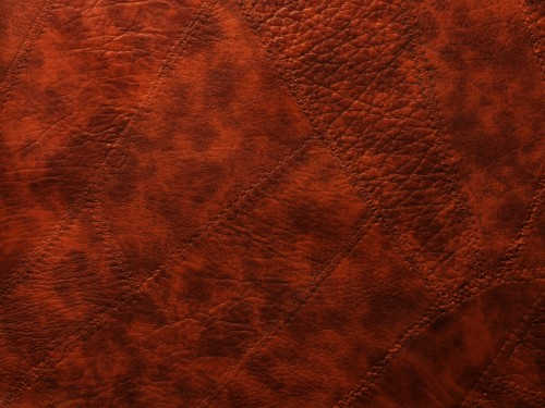 Red Sewed Leather Patches Background