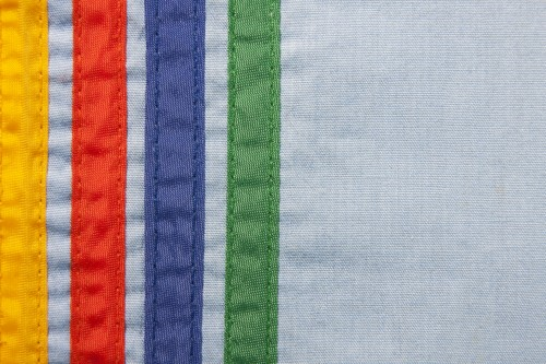 Sewn Colored Stripes On Blue Canvas Background, High Resolution