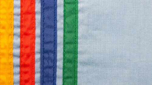 Sewn Colored Stripes On Blue Canvas Background HD 1920 x 1080p